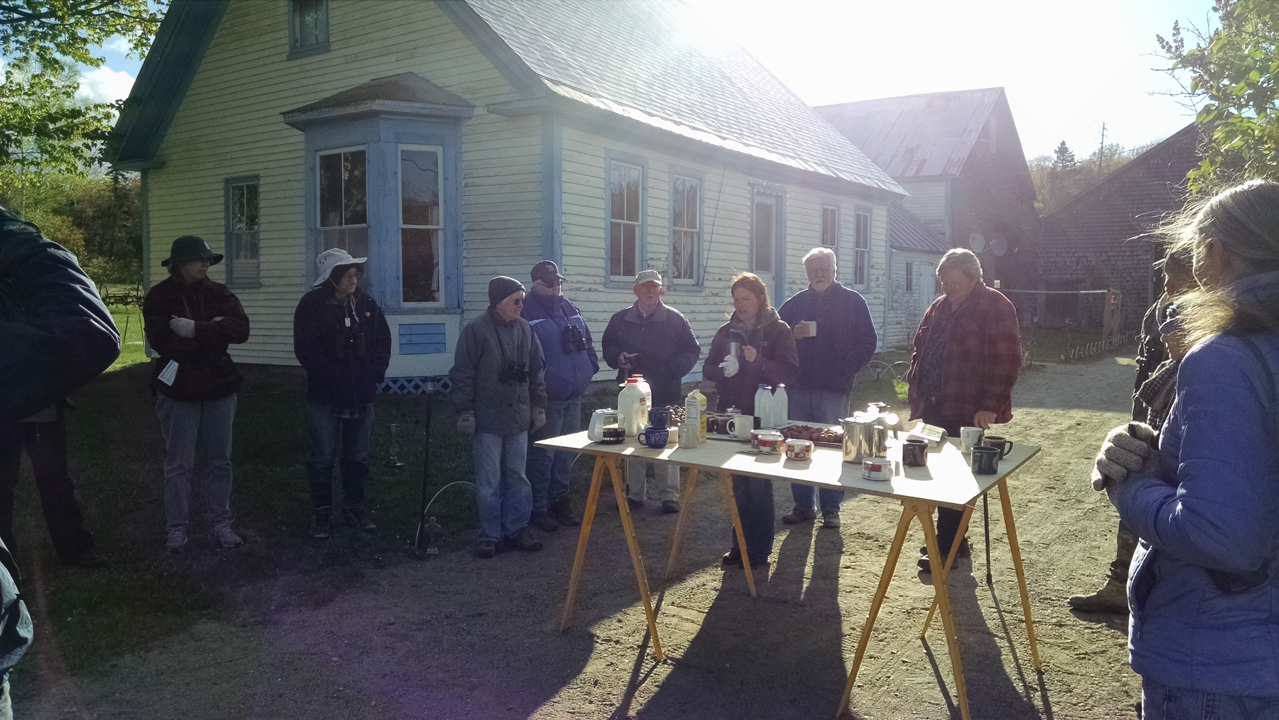 The group gathers at Carson Hinkley's house. Carson maintains the trail which is on his property.